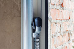 Garage doors installation. Close up of lifting system in metal profil. Stock Images