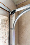 Garage doors installation. Post Rail and Spring Installation / Assembly Stock Photo