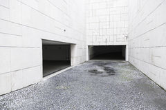 Garage doors in a modern building. Detail of a modern building in the city Royalty Free Stock Photos