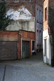 Garage doors and a small alley Royalty Free Stock Photo