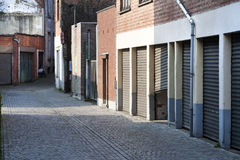 Garage Doors And A Small Alley Royalty Free Stock Photos