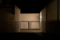 Garage entrance at night. Garage entrance wiith two garages at night Royalty Free Stock Photography