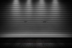 Garage or factory storage gate roller shutter doors metal floor building Royalty Free Stock Photos