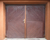 Garage gate. Wooden garage gate on red wall Royalty Free Stock Photography