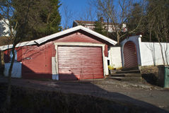 Garage and gate built in wood and masonry. Stock Photo