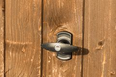 Garage handle on a brown garage door royalty free stock photos