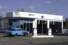 Garage at Havana. Mechanics attending to a classic American car at a garage in Old Havana, Cuba Stock Image