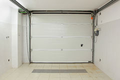 Garage interior. Private garage interior with closed door from inside Royalty Free Stock Images