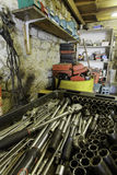 Garage interior with variety of tools. Garage interior with a range of tools and storage on shelving and an extensive socket set in the foreground Stock Image