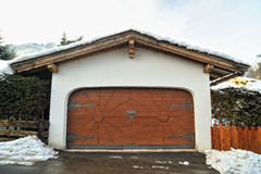 Garage with luxury woode doors with decoration Royalty Free Stock Images