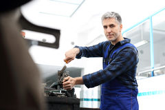 Garage, a man repairing a car Royalty Free Stock Photography