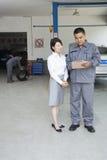Garage Mechanic Explaining to Customer Stock Image
