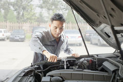 Garage Mechanic Working on Engine Stock Image