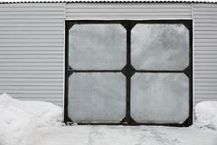 Garage with metal gates in winter stock image