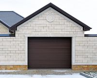 Garage. Garage with modern gate. Design of the facade of the estate royalty free stock photo