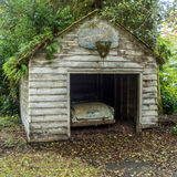 A Garage in the Olympic Rain Forest. An old car in a garage in the Olympic rain forest in Washington Royalty Free Stock Photography