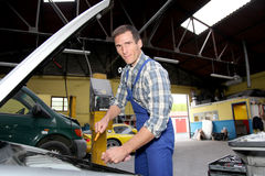 Garage owner at work Royalty Free Stock Photography