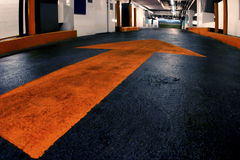 Garage with painted arrow. Photo of garage with painted orange arrow Stock Images