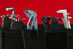 Garage plastic tool box with working tools isolated on blue. Nippers, wrench, hex wrench royalty free stock photos