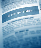 Garage Sale Classifieds. An ad in a classifieds newspaper saying Garage Sales Stock Photos