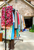 Garage sale. Image of clothes on hangers at a garage sale Royalty Free Stock Photography