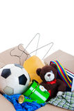 Garage Sale Items. A box of unwanted stuff ready for a garage sale or to donate to a charitable organization.  Generic teddy bear.  Shot on white background Stock Photos