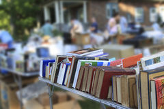 Garage Sale. People are looking around at a garage sale Royalty Free Stock Image