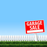 Garage Sale sign. On white fence and clear sky Royalty Free Stock Image