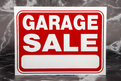 Garage Sale. A garage sale sign against a marble background Stock Photo