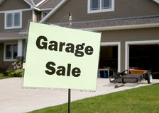 Garage Sale Sign. On a post in front of generic suburban garage Royalty Free Stock Photos