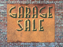 Garage Sale Sign. Rusted Brick Wall Royalty Free Stock Photography