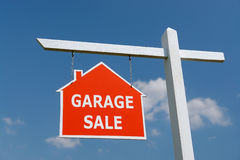 Garage Sale signpost. White wooden post with red Garage Sale notice board over blue sky Royalty Free Stock Image