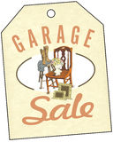 Garage Sale. Spring and summer are the time for home garage sales!  Antiques, clothing, colorful goods are stacked outside the house. Junk to some, shopping to Stock Photo