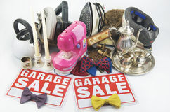 Garage Sale Stuff. A collection of garage sale things on white and with two garage sale signs Royalty Free Stock Photo