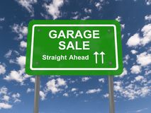 Garage sale. Text 'garage sale' in white uppercase letters on a green roadside style board with words 'straight ahead' underneath and arrows pointing straight Stock Images