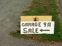 Garage sale today. Box with sign for garage sale Stock Photography