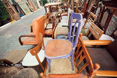 Garage sale with wooden furniture and different chairs Stock Image