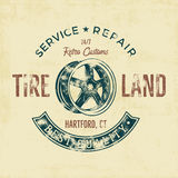 Garage service vintage tee design graphics, Tire land, repair service typography print. T-shirt stamp, teeshirt graphic Royalty Free Stock Images