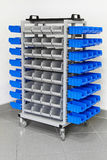 Garage shelves trolley. Trolley with plastic shelves for garage shop Stock Photo