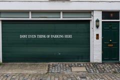 Garage sign prohibiting parking Stock Image