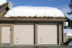 Garage with snow. Double garage with turfed roof covered with snow Royalty Free Stock Images