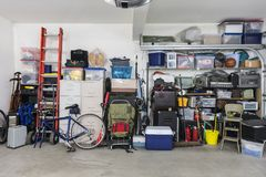Free Garage Storage Shelves With Vintage Objects And Equipment Royalty Free Stock Images - 122759009