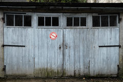 Garage with weathered white doors Royalty Free Stock Images