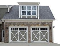 Garagem da porta dobro na casa moderna Fotografia de Stock Royalty Free