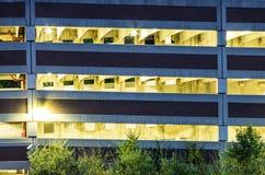 Garagem de estacionamento iluminada na noite Imagem de Stock Royalty Free