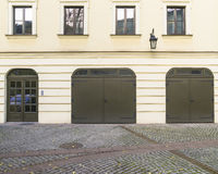 Garages and door. Garages in the courtyard of the building. Part of the Palace of the Bishops in Krakow , Franciszkańska street royalty free stock photos