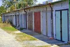 Garages door. Old row of garages colors royalty free stock photography