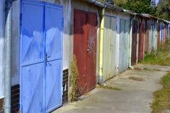 Garages door. Old row of garages colors stock photos