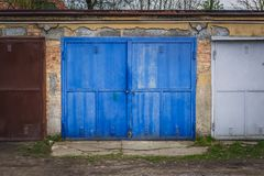 Garages in Roznov pod Radhostem. Row of old garages with metal gates in Roznov pod Radhostem, small town in Czech Republic stock image