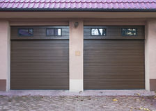 Garages. Two suburban garages, closed automatically stock images